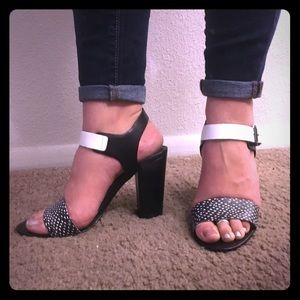Classy black and white staple heeled sandals.